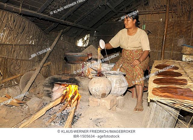 Intha woman producing rice snacks, Inle Lake, Shan State, Myanmar, Southeast Asia, Asia