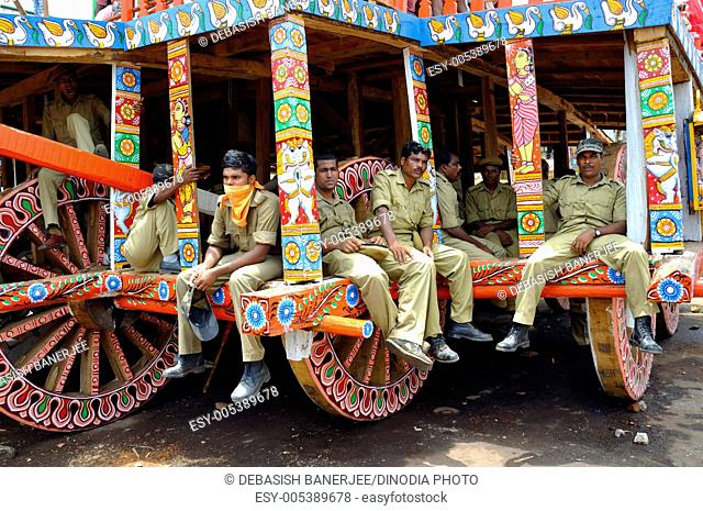 Guards taking rest in chariot rath yatra of jagannath ; Puri ; Orissa ; India NO MR