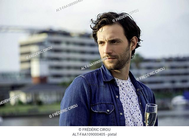 Man drinking champagne outdoors