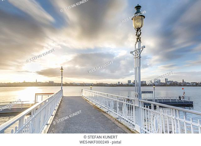 Germany, Hamburg, historic ferry pier at the Aussenalster at sunrise
