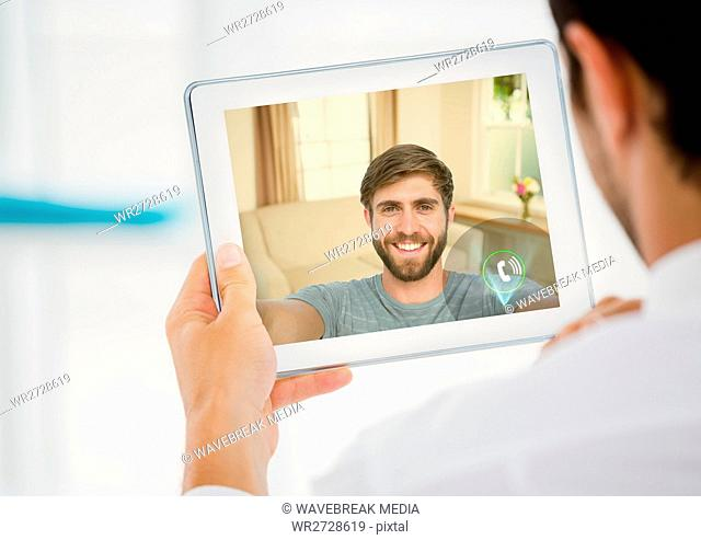 Man having a video call with his friend on digital tablet