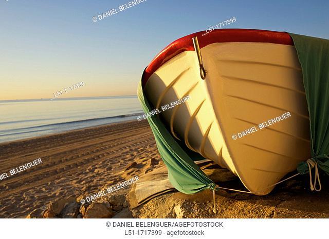 small boat at Santa Pola beach, Salinas de Santa Pola Nature Reserve, Santa Pola, Alicante, Spain