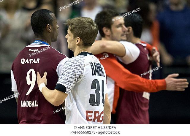 Qatar's Rafael Capote (L-R), Germany's Rune Dahmke, Germany's goalkeeper Carsten Lichtlein and Qatar's Zarko Markovic shake hands and hug after the...