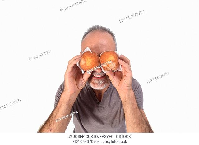 man with muffin on white background