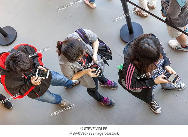 China, Hong Kong, Apple Store Customers Using Electronic Devices