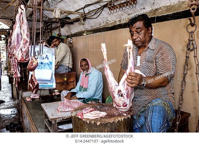 India, Asian, Mumbai, Lower Parel, Sunday Market, meat vendor, shopping, selling, sale, butcher, working, man