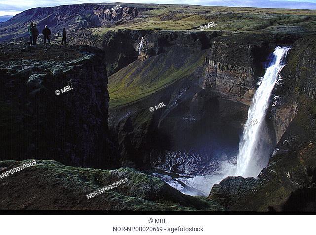 People lookin at the waterfall Haifoss in Thjorsardalur
