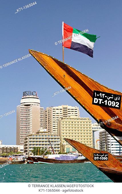 Office towers and the national flag of the UAE along Dubai Creek in Dubai, UAE, Persian Gulf