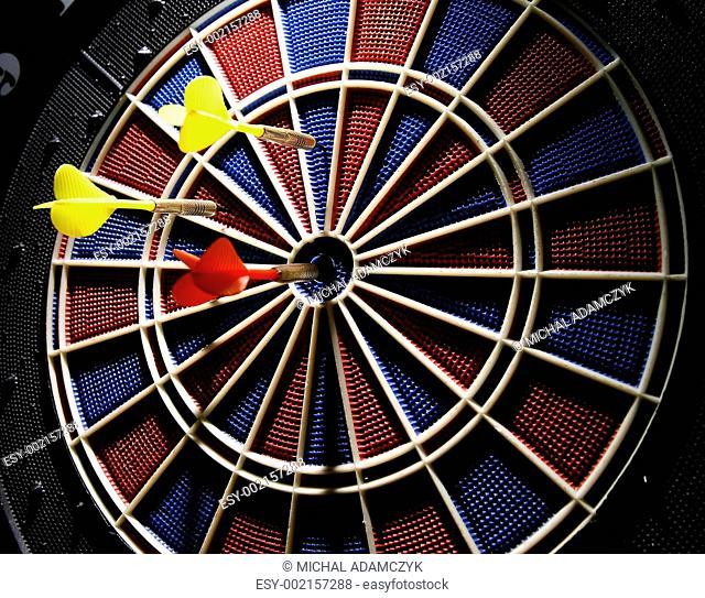 dart board with three darts