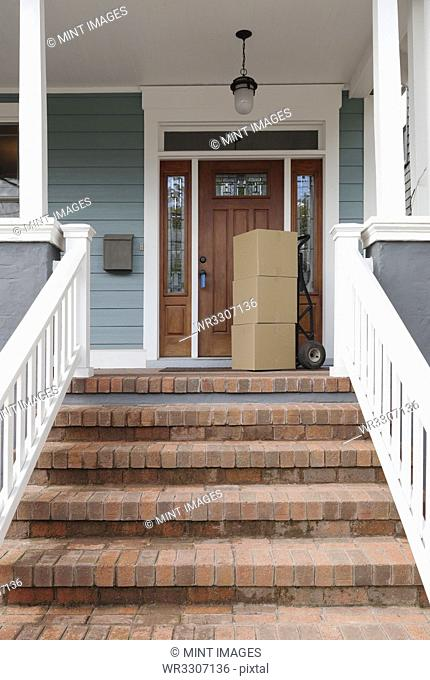Cardboard boxes on front porch of new house