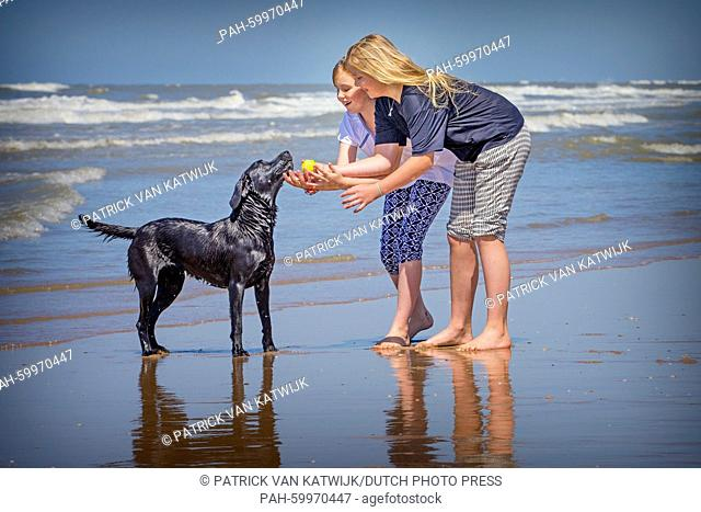 Princess Amalia and Princess Alexia of The Netherlands pose for the media at the start of their summer holidays at the beach of Wassenaar, The Netherlands