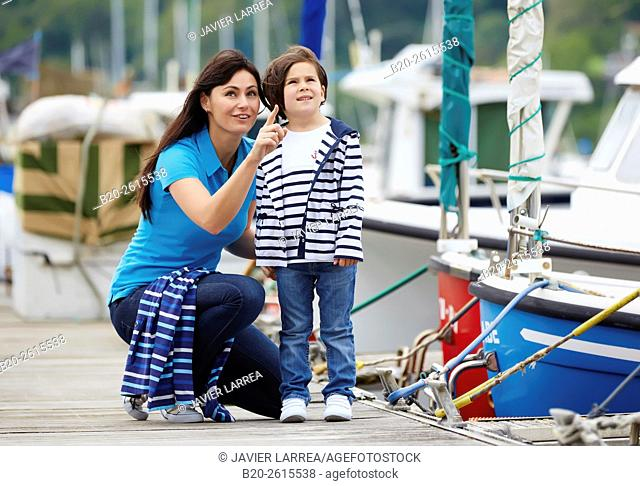 Mother and daughter in the marina. Port. Getaria. Gipuzkoa. Basque Country. Spain