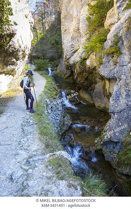 Woman hiker in a gorge. Desfiladero del Rio Puron route. Valderejo Natural Park, Alava, Spain, Europe