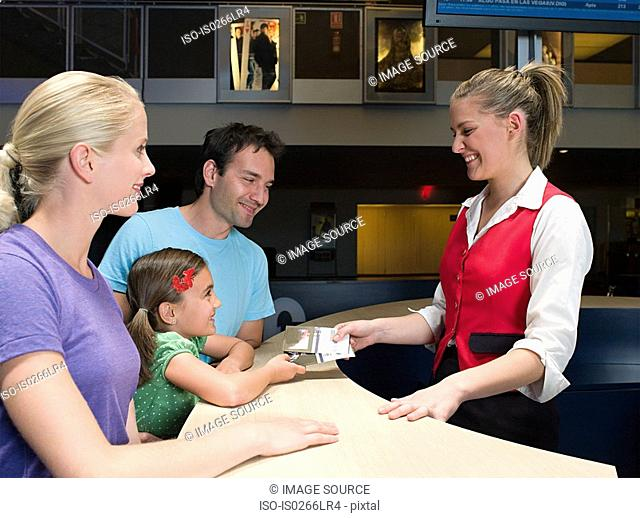 A family buying tickets from the box office