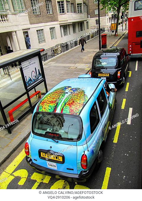 Traditional London Taxi in the heart of London, England, UK