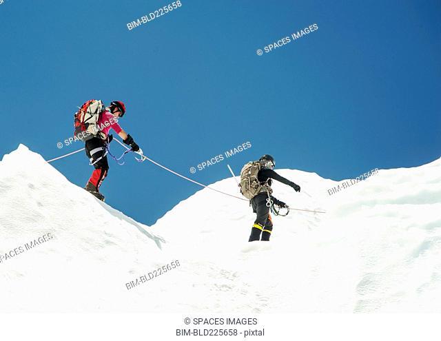 Women hiking on snowy mountain, Everest, Khumbu region, Nepal