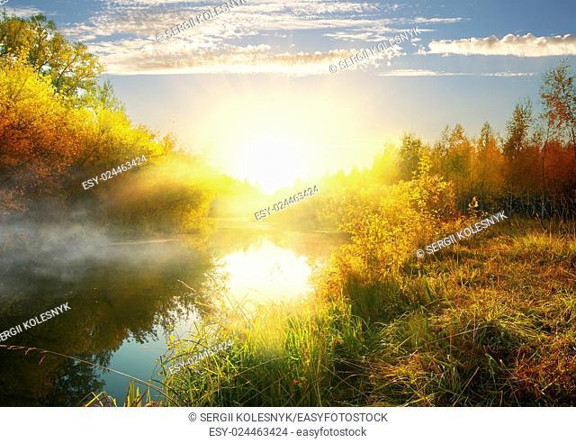 Calm river in autumn at the sunrise
