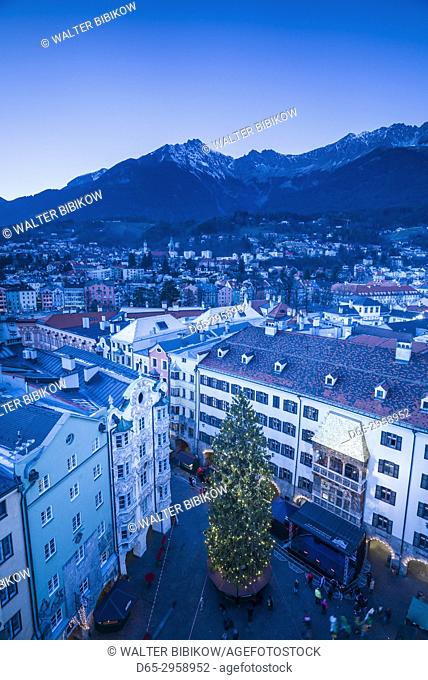 Austria, Tyrol, Innsbruck, elevated view of the Golden Roof, Goldenes Dachl, Christmastime, dusk