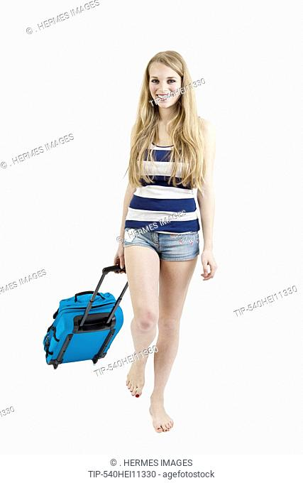 Young beautiful woman with trolley