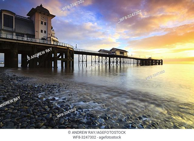 Sunrise at Penarth Pier in South Wales, captured from the waters edge in mid February using a long shutter speed to blur the movement in a receding wave