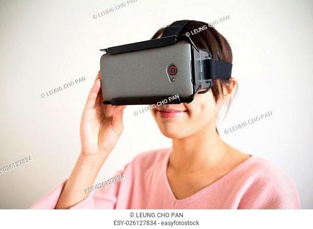 Young Woman use of the vr device