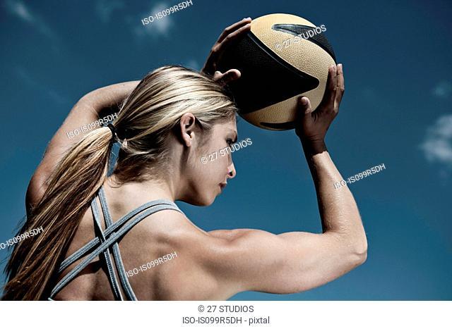 Woman holding ball