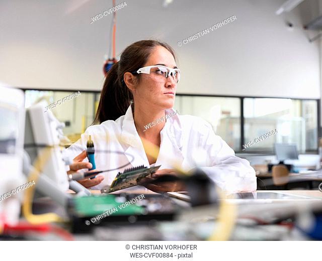 Female technician working in research laboratory
