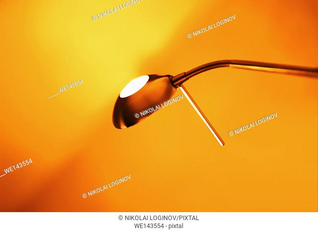 Diagonal orange office lamp bokeh background