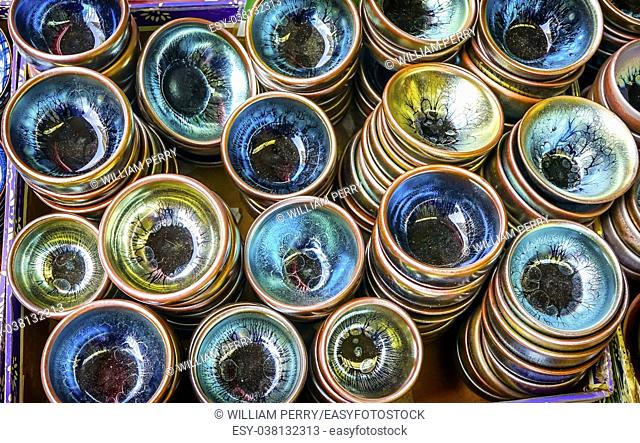 Old Chinese Ceramic Glass Plates Panjuan Flea Market Beijing China. Panjuan Flea Curio market has many fakes, replicas and copies of older Chinese products