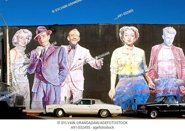 Cars by mural on a wall, Los Angeles downtown. California, USA
