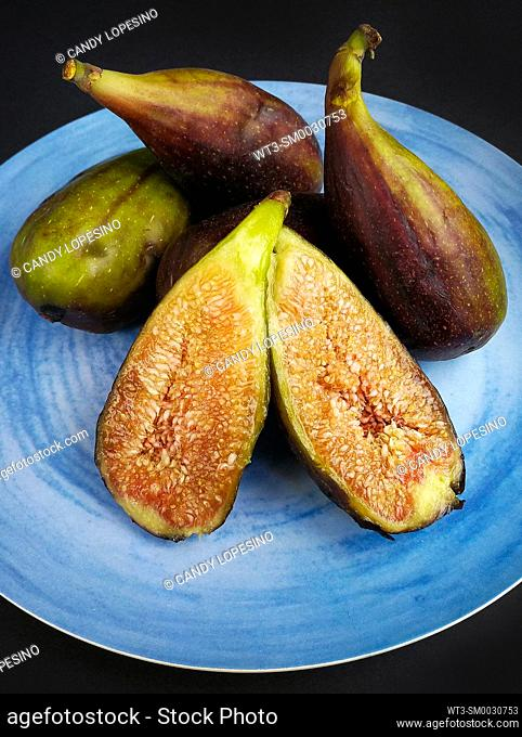 Five figs on a blue plate