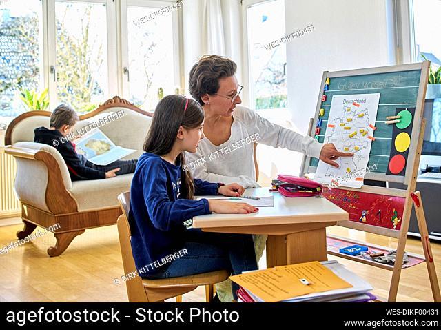 Mother home schooling her daughter