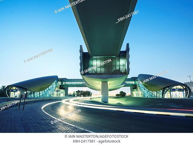 Modern metro railway station at night in Dubai United Arab Emirates