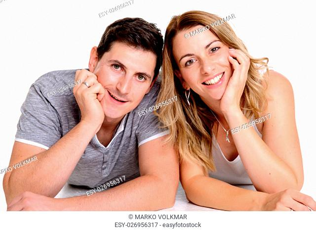 young beautiful couple in front of white background