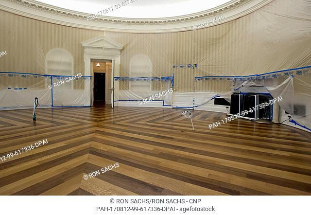 Plastic covers the walls of the Oval Office in the White House West Wing in Washington, DC as it is undergoing renovations while United States President Donald...