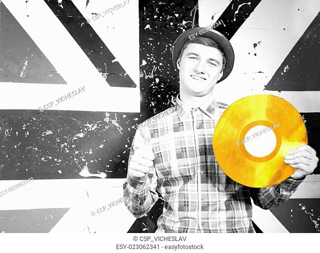 Smiling Man in Monochrome with Golden Vinyl Record