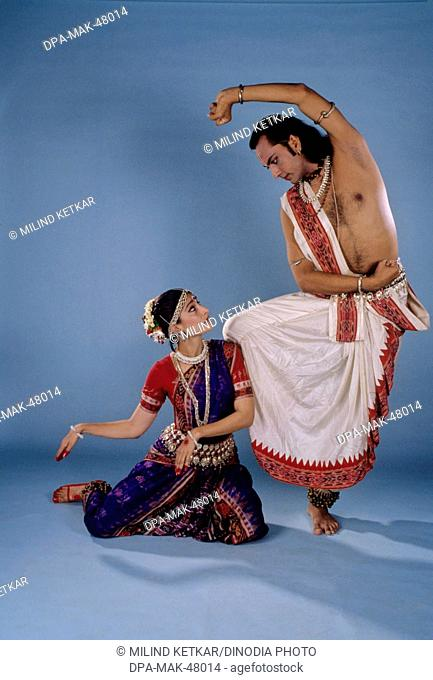 pair performing indian classical odissi dance , india , MR