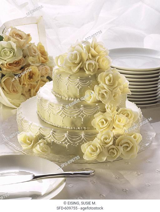 Three Tier Wedding Cake, Floral Bouquet, Plates & Cake Server