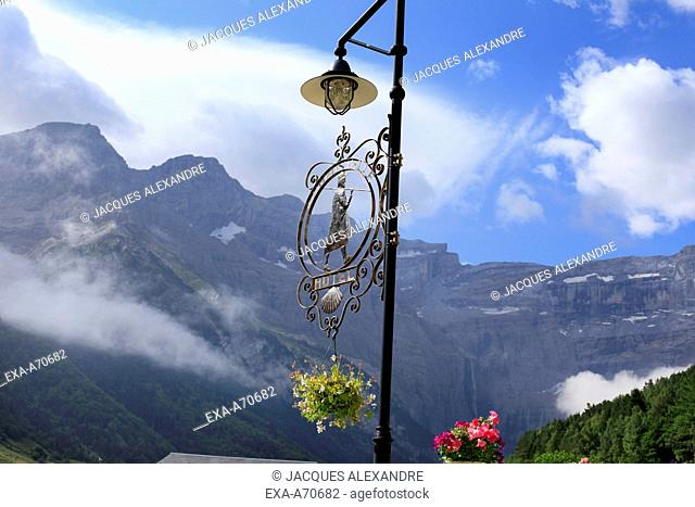 Lantern with shield of the Jacob pilgrims with view on the Cirque de Gavarnie, Pyrenees mountain, France