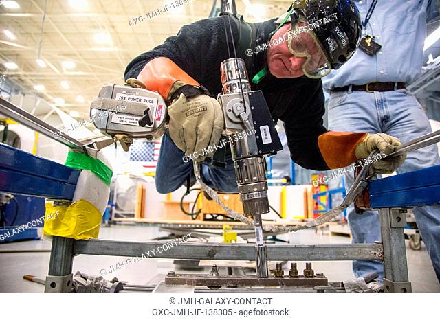 NASA astronaut Scott Kelly, Expedition 4344 flight engineer and Expedition 4546 commander, participates in an extravehicular activity (EVA) training session in...