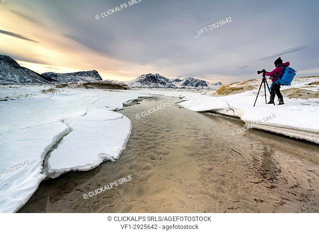 Hauckland Beach, Vestvagoy, Lofoten island, Norway Photographer records the sunrise in the beach