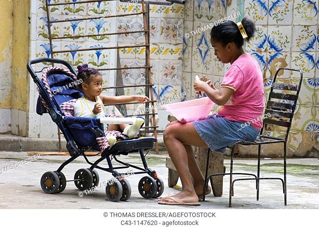Cuba - Woman with child in a courtyard in Cuba's capital Havana