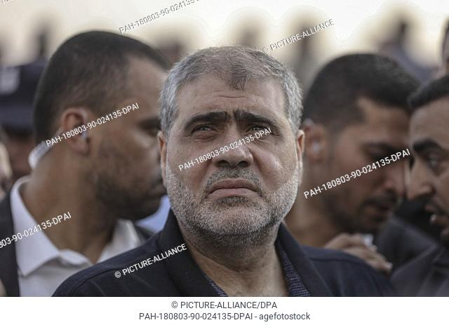 Mohammed Nasser, prominent leader in the Hamas Palestinian Islamist movement (C) takes part in a protest along the Israel-Gaza border, in Jabalia
