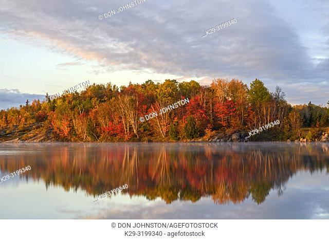 Autumn reflections in Simon Lake at dawn, Greater Sudbury, Ontario, Canada