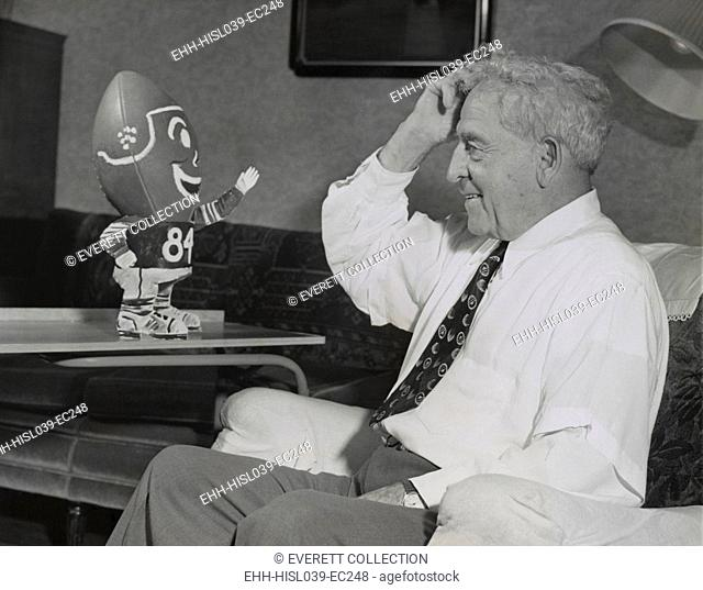 Amos Alonzo Stagg smiling at football creature. On his 84th birthday, the football pioneer had been coaching for more than half a century. Aug
