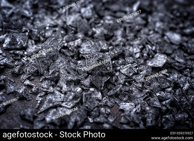 Traditional gourmet pyramid salt flakes offered as close-up on a rustic black board