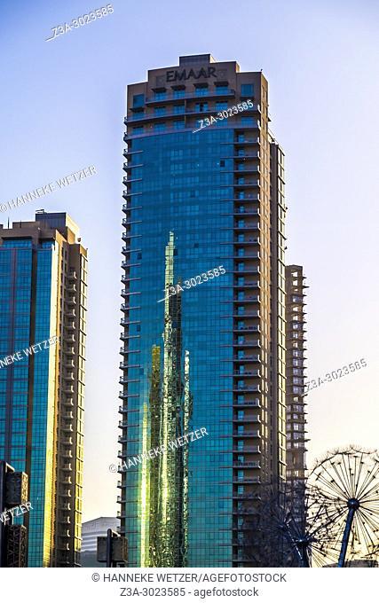 Emaar Properties Tower reflected in Emaar skyscrapers in Dubai