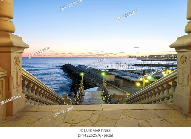 Sunset in the beautiful Sitges downtown, village near to Barcelona; Sitges, Spain