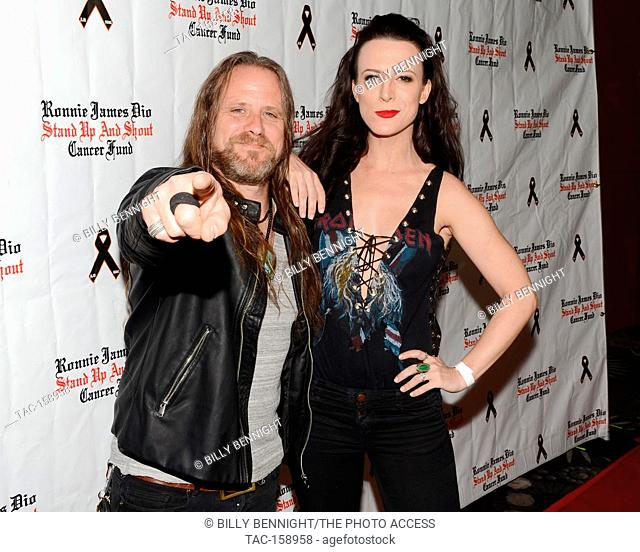 """Chris Latham and Calico Cooper arrives at the 3rd Annual """"""""Bowl 4 Ronnie"""""""" Celebrity Bowling Tournament, benefiting the """"""""Ronnie James Dio Stand Up and Shout..."""