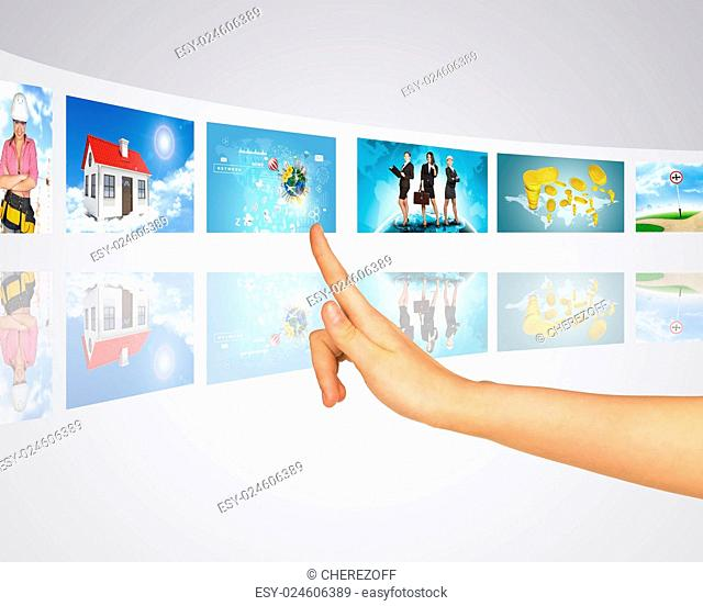 Business lady, home, construction. Finger presses one of virtual screens. Mirror reflection